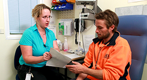 Teaching a patient 5774894486 by Dept of Immigration and Boarder Protection AUS no stethoscope.jpg