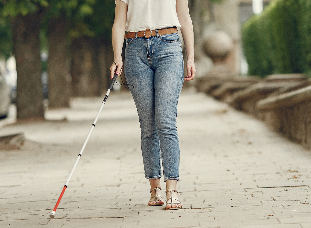 person walking with white cane