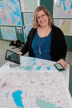 Photo of Jocelynn Johnson at work as a geospatial analyst with the Manitoba government.