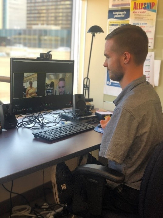 A photo of Matt Reimer using Zoom on a computer.